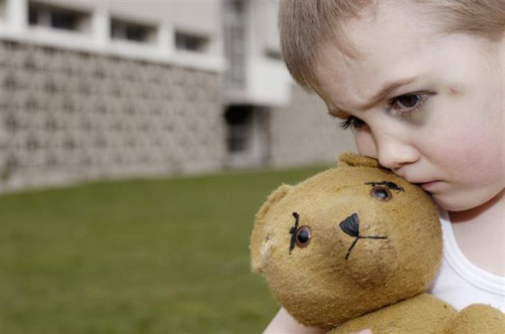 Abused Child With Teddy Bear