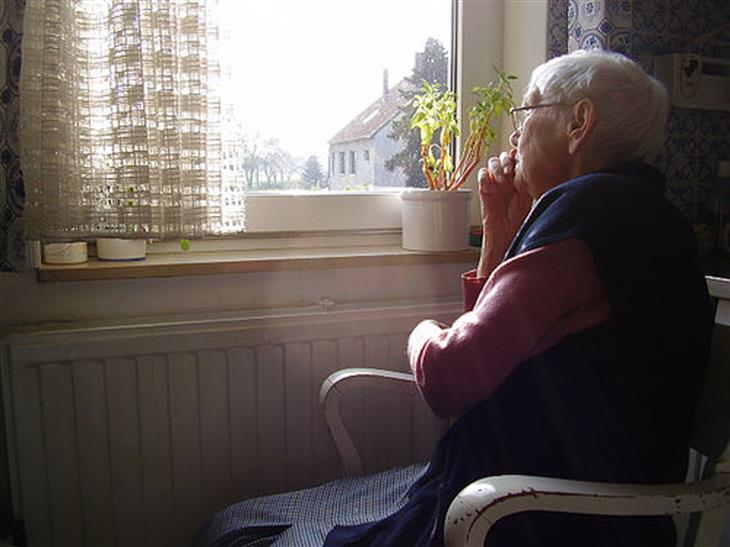 Elderly Looking Out Window