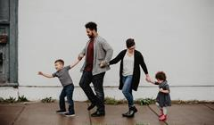 Family Of Four Walking At The Street 2253879
